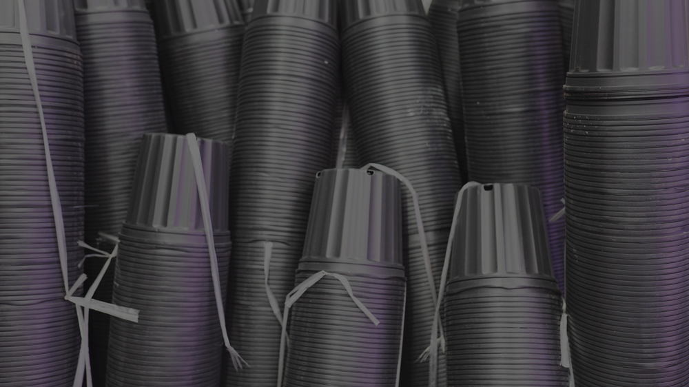 Stack of 3 gallon black plastic pots