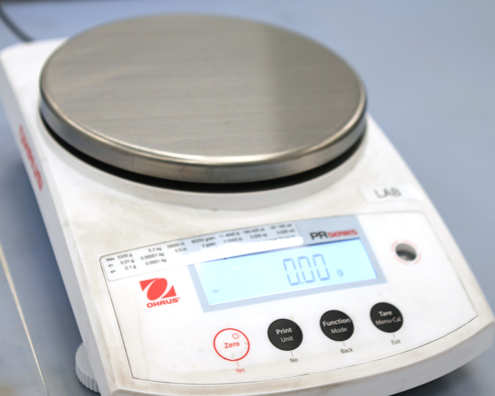 Ohaus digital weight scale.